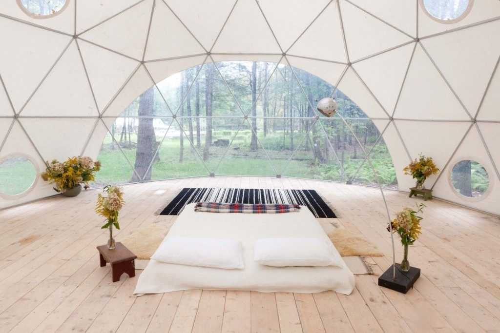insite of a cabin in the woods with dome like architecture